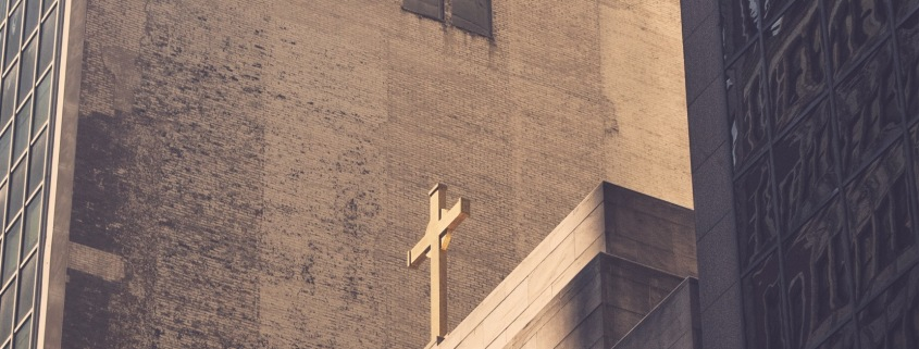 cross in the city landscape