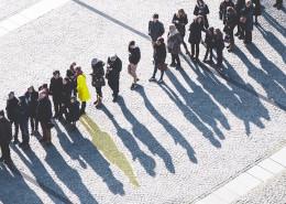 yellow coat in queue