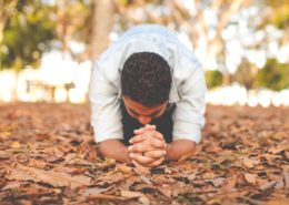 kneeling on dead leaves