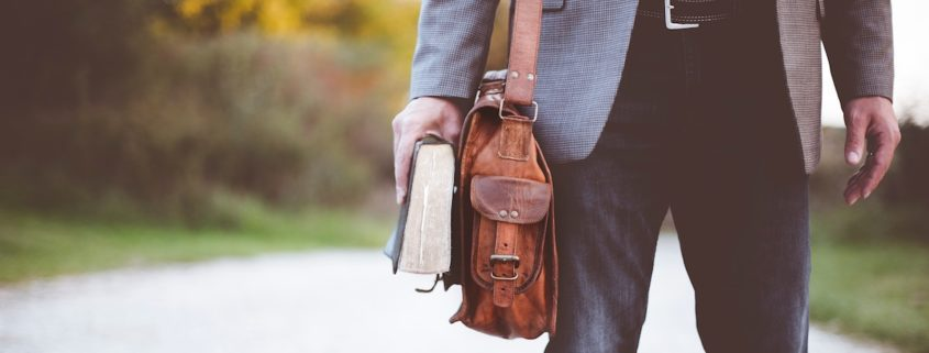 man with bag and bible