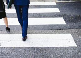business people crossing zebra